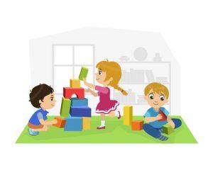 dzieci bawiące się na dywanie w psali przedszkolnej
